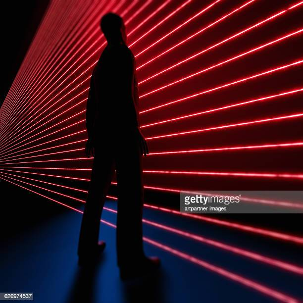 man standing in front of laser