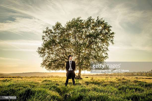 Man standing in front of tree