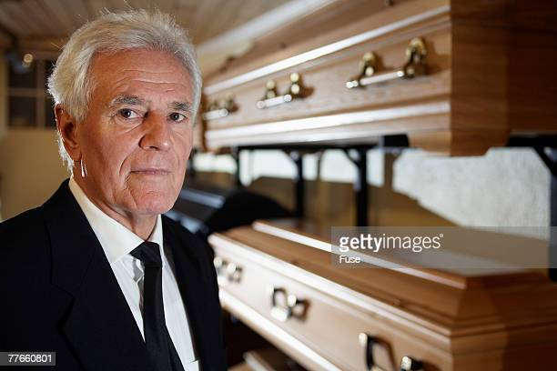 Man Standing in Funeral Parlor