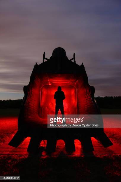 man standing in giant excavator bucket - coal mining stock photos and pictures