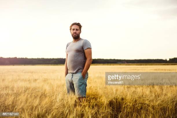 Man standing in grain field