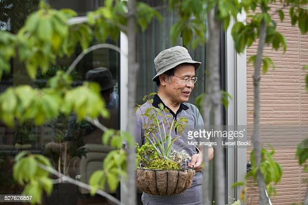 A man standing in his garden.