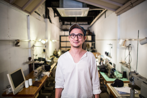 A man standing in his textile studio - gettyimageskorea