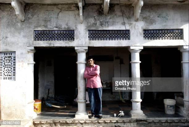 Man Standing in House, Dilwara, Rajasthan, India