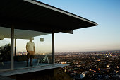 Man Standing In House Overlooking Los Angeles.