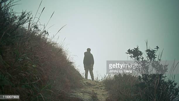 Man standing in mist