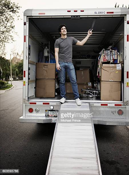 Man Standing in Moving Van