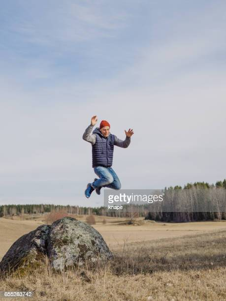 Man standing in nature jumping
