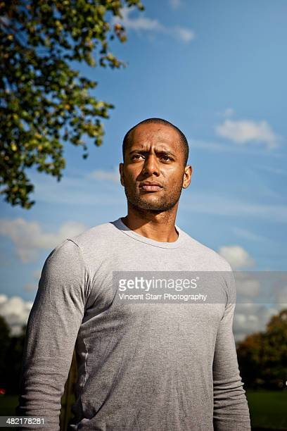 man standing in park - long sleeved stock photos and pictures