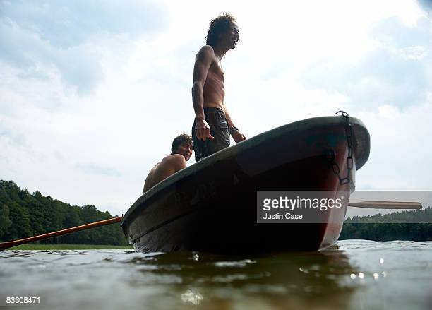 Man standing in row boat