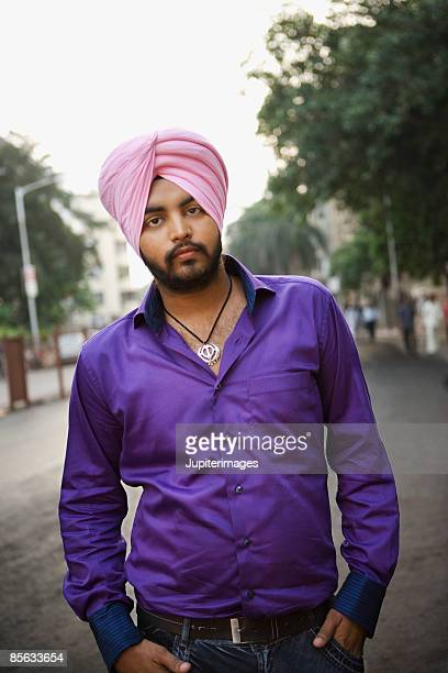 man standing in street - turban stock pictures, royalty-free photos & images