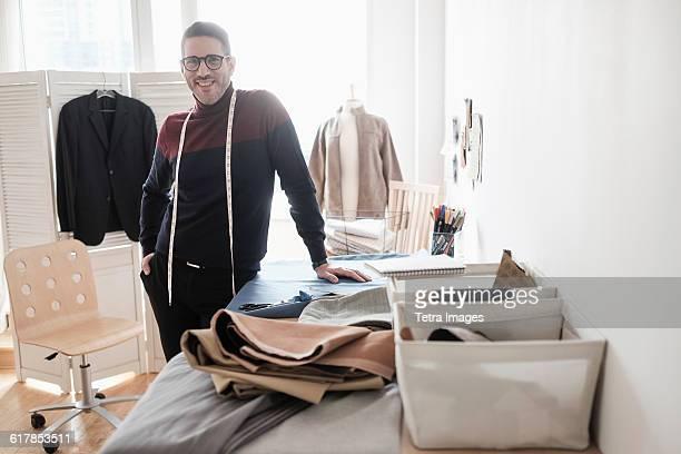 Man standing in tailors workshop