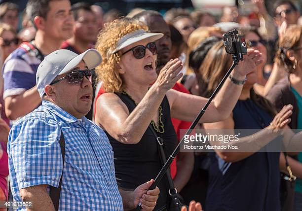 SQUARE TORONTO ONTARIO CANADA Man standing in the crowd clicking a selfie using a selfie stick at MexFest 2015 MexFest 2015 is celebration of all...