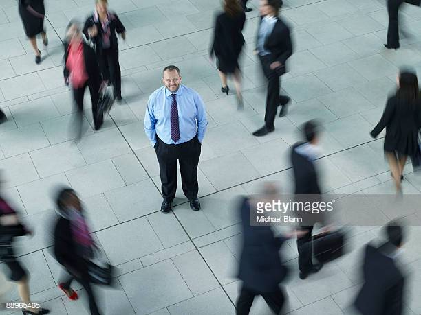 man standing in the middle of a busy crowd
