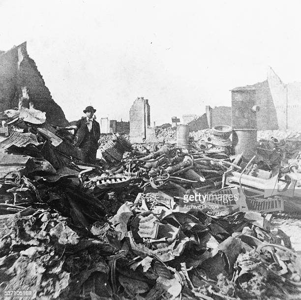 A man standing in the ruins of a stove warehouse in the aftermath of the Great Chicago Fire October 10th 1871
