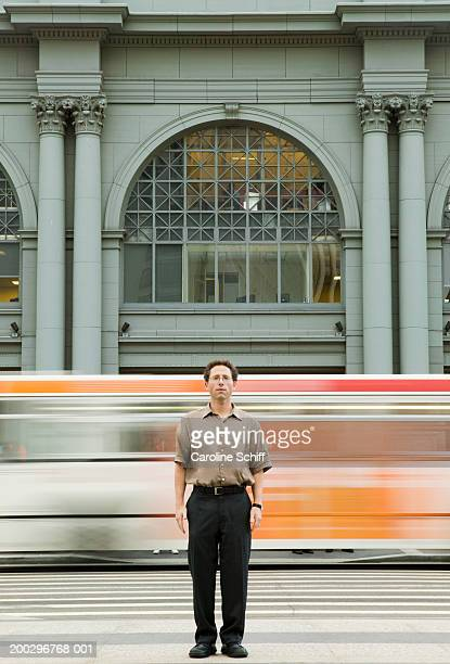 man standing in urban road, portrait (blurred motion) - schiff stock photos and pictures