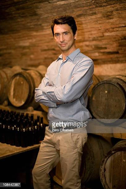 man standing in wine cellar - three quarter length stock pictures, royalty-free photos & images