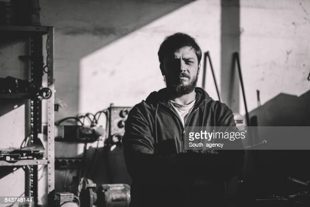 man standing in workshop - drill bit stock photos and pictures