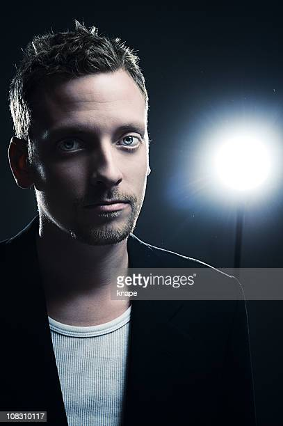Man standing infront of a spotlight