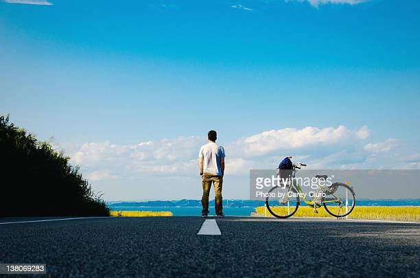 Man standing middle of road