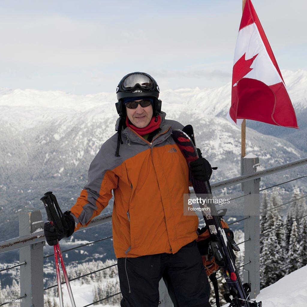 Man standing near Canadian flag : Stock Photo