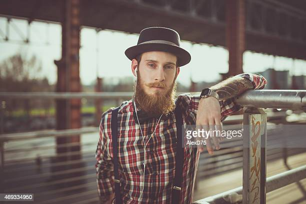Man Standing near Fence