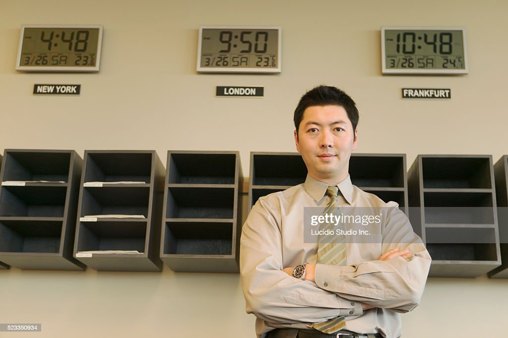 Man Standing Near Office Mail Slots : Stock Photo