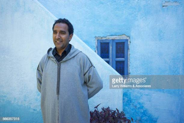 man standing near painted stairs, fes, fes-boulemane, morocco - homme marocain photos et images de collection
