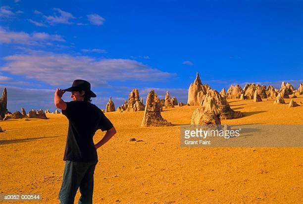 Man Standing near Pinnacles