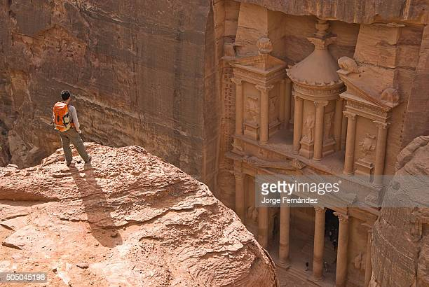Man standing near the edge to take a better view of the Treasury from the top Petra