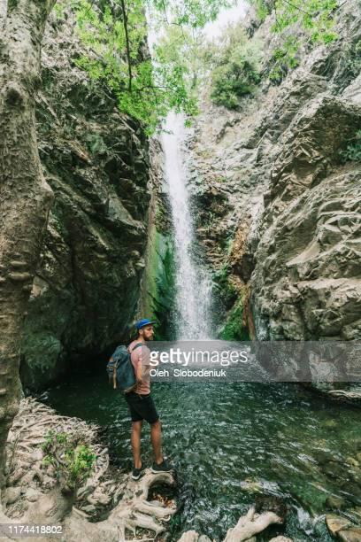man staande in de buurt van de waterval - cyprus stockfoto's en -beelden