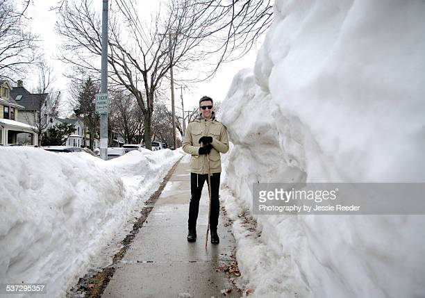 man standing next to huge pile of snow - madison wisconsin stock pictures, royalty-free photos & images
