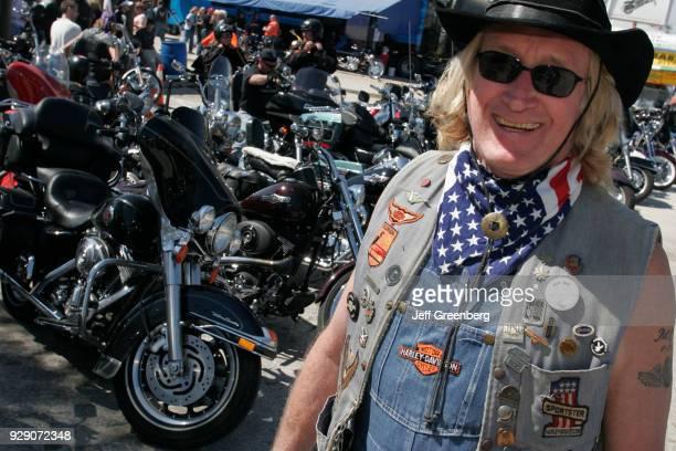 A man standing next to motorbikes at Bike Week Daytona Beach