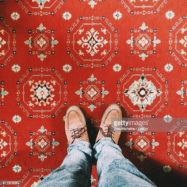 Man standing on a beautiful carpet