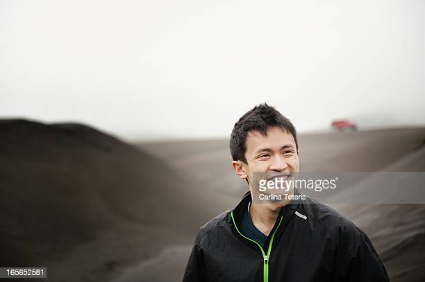 a man standing on a black sand dune - vietnamese ethnicity stock pictures, royalty-free photos & images