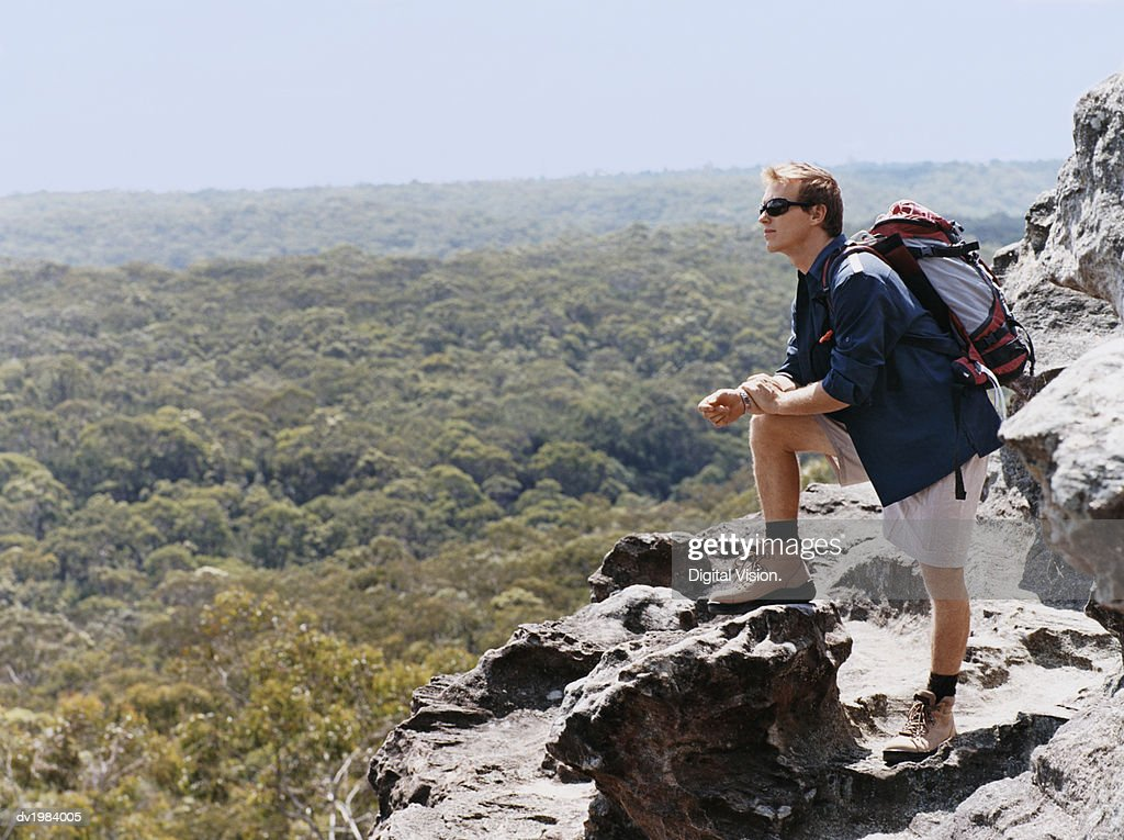 Man Standing on a Mountain Summit Looking at View : Stock Photo