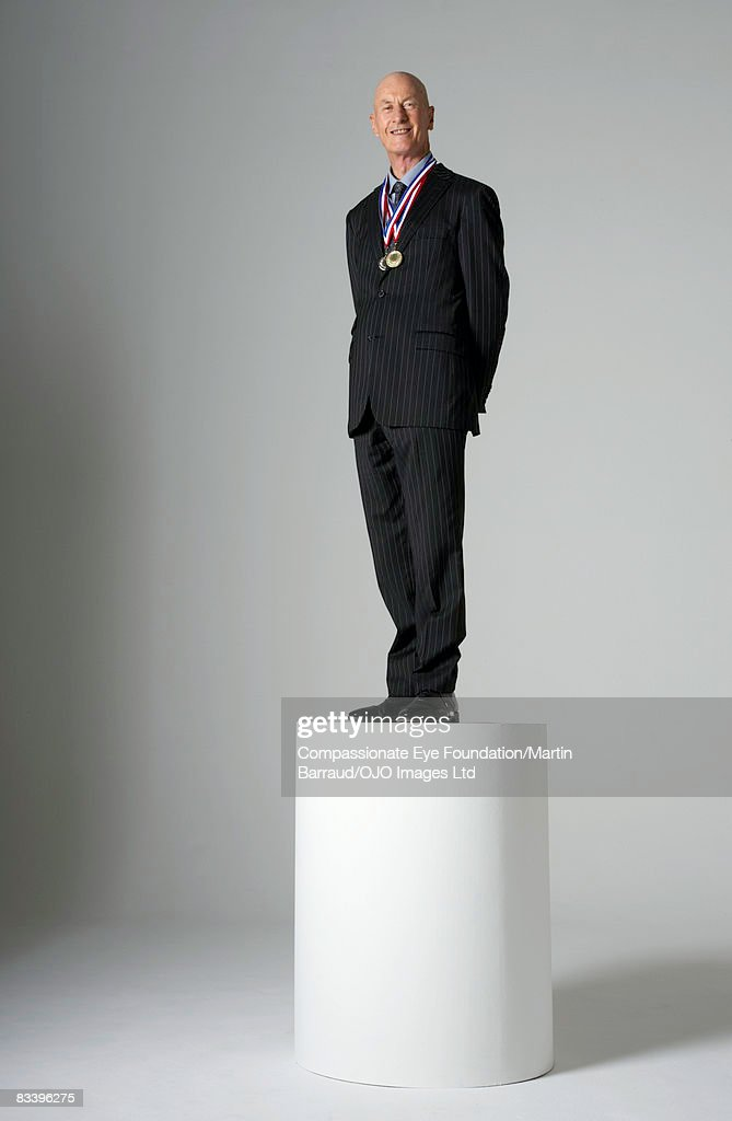 Man Standing On A Pedestal Wearing Medals High-Res Stock Photo ...