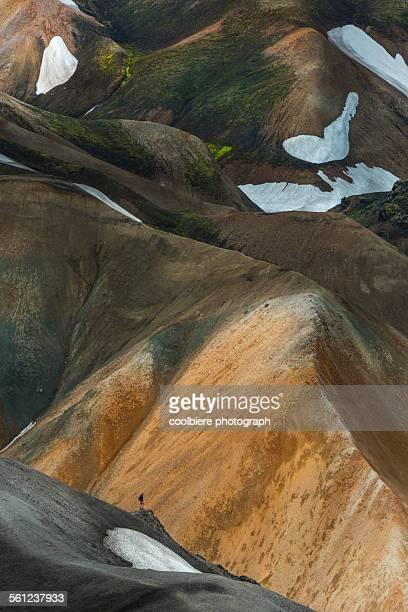 A man standing on a ridge