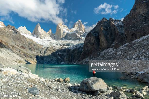 man standing on a rock above laguna sucia, el chalten, argentina. - chalten stock pictures, royalty-free photos & images