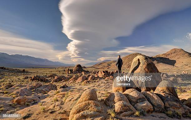 Man standing on a rock, Alabama Hills, Inyo County, California, USA