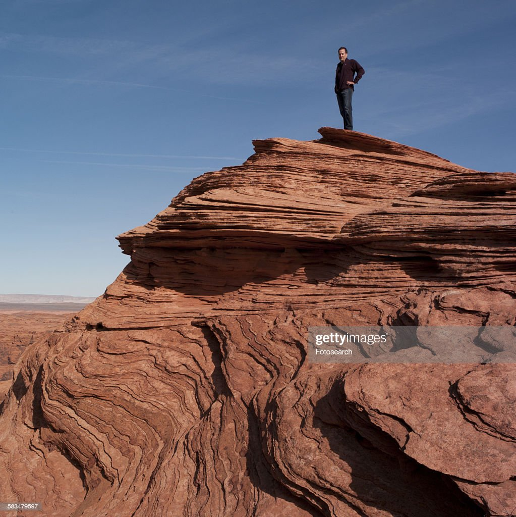 Man standing on a rock : Stock Photo