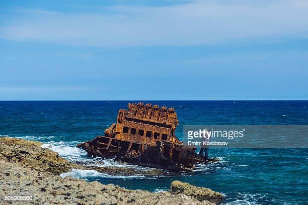 Man standing on a shipwreck near Gibara, Cuba