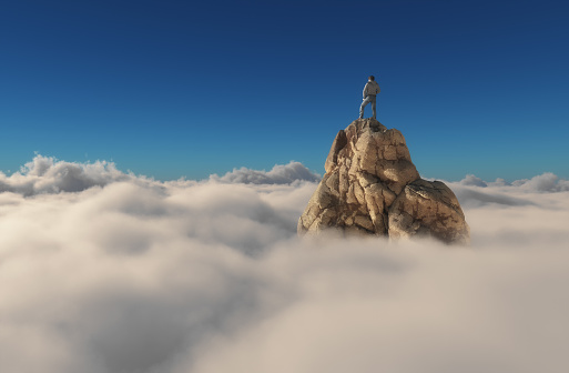Man standing on a stone cliff 612507606