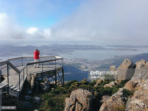 man standing on a viewing platform taking photo's - hobart tasmania stock pictures, royalty-free photos & images