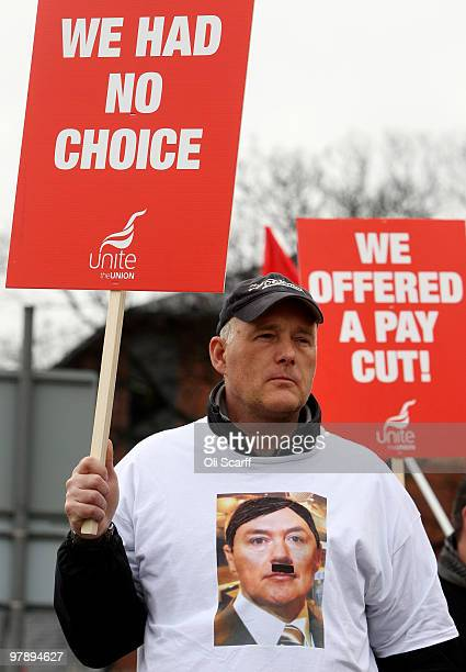 A man standing on an official picket line outside Heathrow airport wears a Tshirt depicting BA Chief Executive Willie Walsh as Adolf Hitler on the...