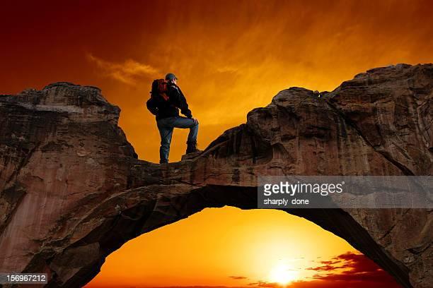 XXXL man standing on arch