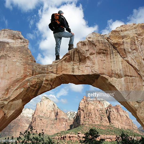xxxl man standing on arch - arch stock pictures, royalty-free photos & images