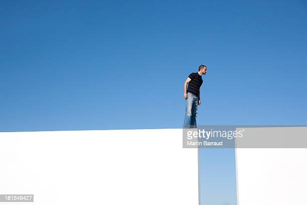Man standing on blocks outdoors with looking down