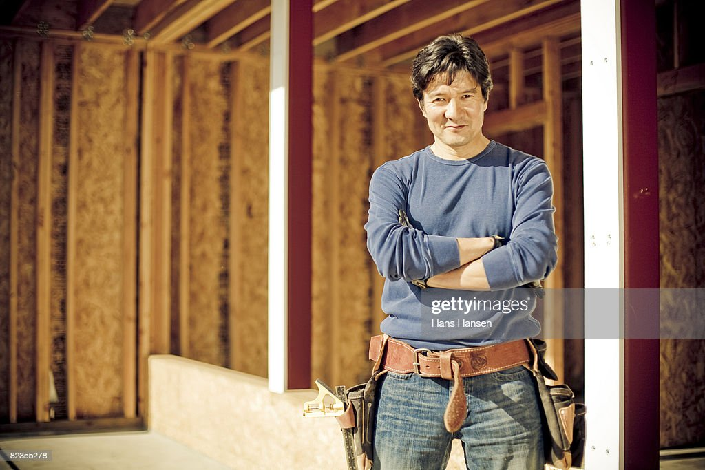 Man standing on construction site with tools : Stock Photo