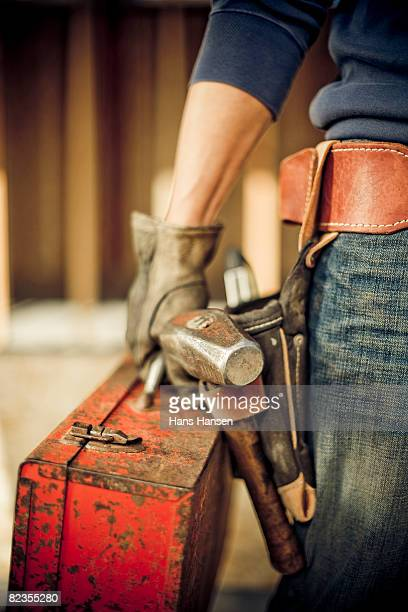 man standing on construction site with tools - toolbox stock photos and pictures